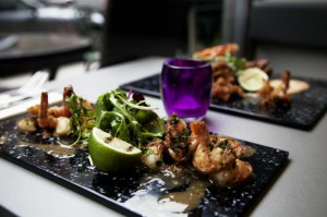 Tiger prawns with garlic, chilli and mixed leaves