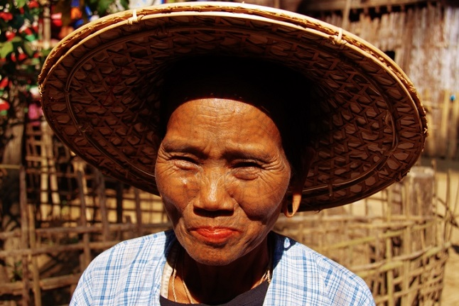 Chin woman with a detailed facial tattoo. Credit@Photoasia via flickr.com