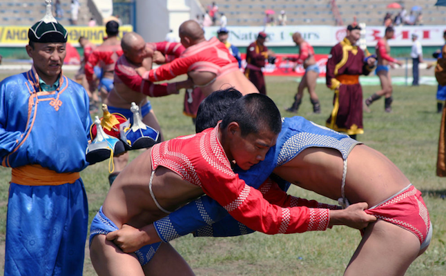 Wrestling at the Naadam Festival credit@Michael Reeve via flickr.com