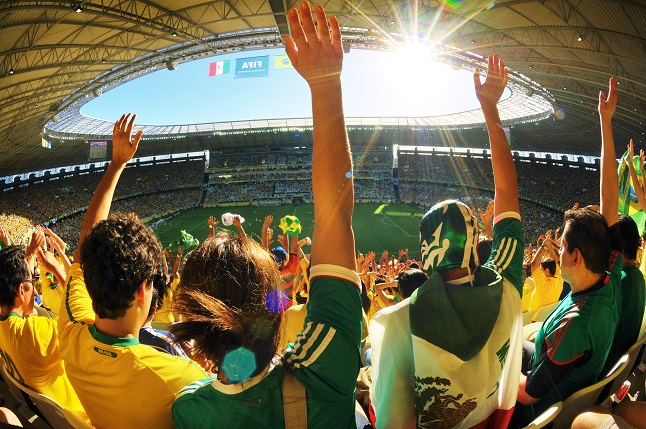 Brazil fans celebrate as they watch their country play in their home country.  Credit@CrystianCruz via flickr.com