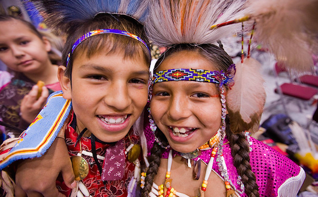 Two traditional Crow dancers from Montana Credit@ Adam sings in timeber via flickr.com
