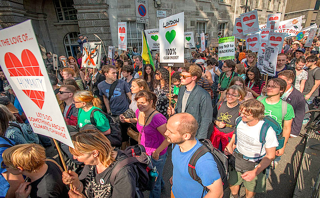 Peoples Climate campaigners marching through London. Credit@askbeforepresumingviaflickr.com