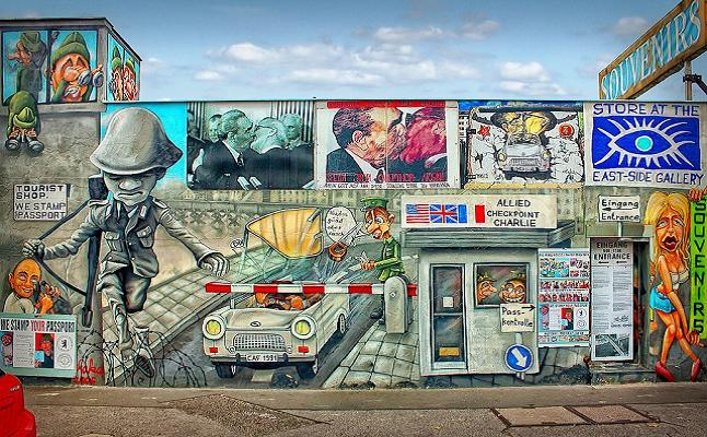 Part of the artwork displayed at the East side gallery, Berlin. Credit@ Peter Dargatz