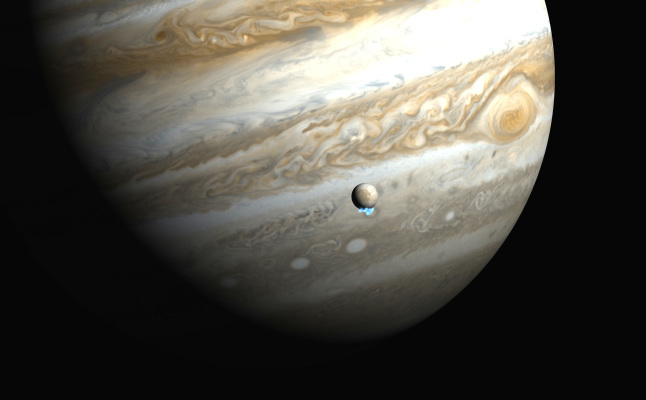This artist's impression shows Jupiter and its moon Europa using actual Jupiter and Europa images in visible light. The Hubble ultraviolet images showing the faint emission from the water vapour plumes have been superimposed, respecting the size but not the brightness of the plumes. Credit@HubbleESA