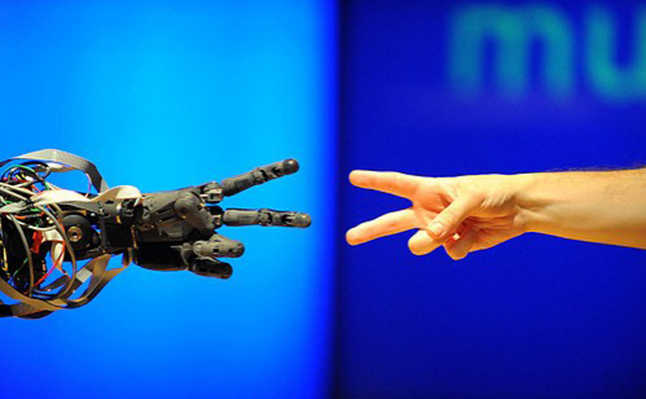 Closing the divide between human and artificial intelligence. Credit@ EmilieOgez