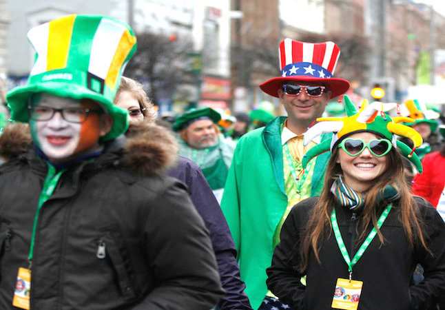 Parade in session with participants wearing the traditional Irish green. Credit@stpatricksfestival