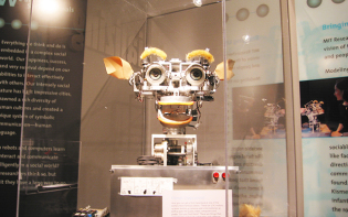 Kismet, a robot with rudimentary social skills in MIT Museum during Wikimania 2006. Credit@Polimerek