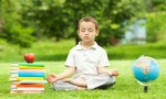 Young boy meditating.Credit@yogaforlife