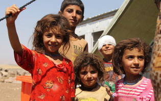 Some of the 12,000 Iraqi Yazidi refugee children in high spirits having left the province of north eastern Syria and being aided by the International Rescue Committee with medical care, shelter and  games for the children.Credit@Flickr.