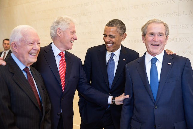 President Barack Obama laughs with former Presidents Jimmy Carter, Bill Clinton, and George W. Bush, 2013.Credit@simplewikipedia