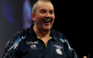 Phil Taylor celebrates winning a match in the tournament. Credit @pinterest,com.