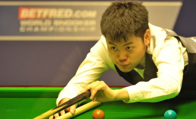 Liang Wenbo taking a shot in the final of the English Open. Credit @pinterest.com.