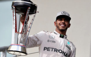 Lewis Hamilton holding the trophy for the American Grand Prix aloft. Credit @tumblr.com.