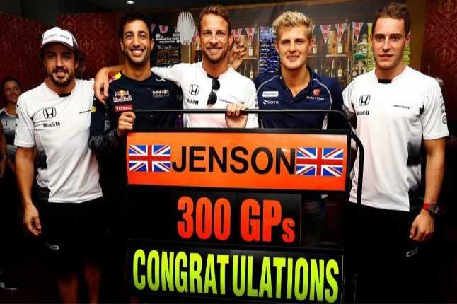 Jenson Button celebrating reaching his milestone with colleagues and team members. Credit @tumblr.com.
