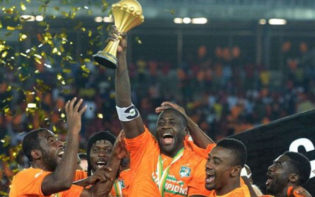 Yaya Toure lifts the African Cup of Nations. Credit @pinterest.com.