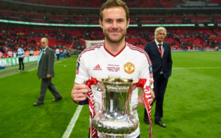 Juan Mata holding the FA Cup trophy after Manchester United's victory last season. Credit @tumblr.com.