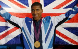 Anthony Joshua celebrating his Olympic gold medal. Credit @pinterest.com.