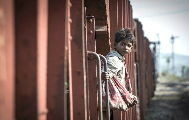 A young Saroo Brierley on a train in India ©THE WEINSTEIN COMPANY INC. ALL RIGHTS RESERVED.