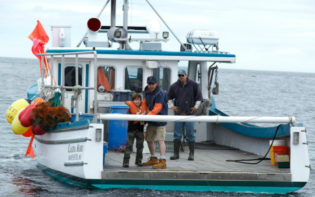 Taking the boat out to sea in Manchester by the Sea Credit@Courtesy of Amazon Studios and Roadside Attractions