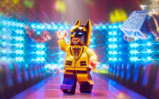 Lego Batman demonstrates his various costumes in his latest adventure. Credit @ The LEGO Group. ™ & © DC Comics. © 2016 Warner Bros. Ent. All Rights Reserved.