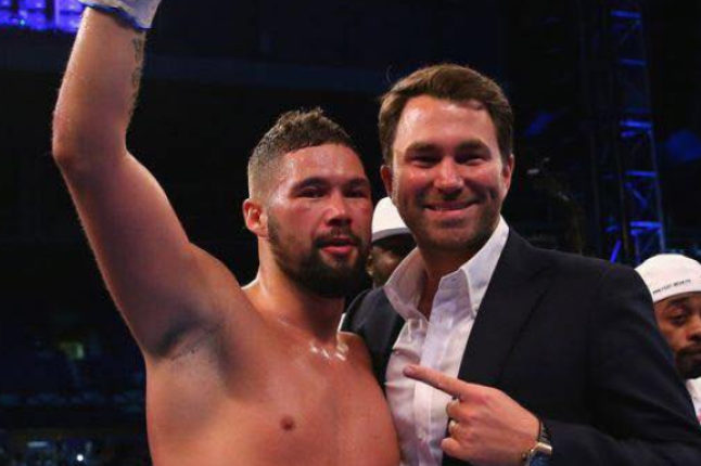 Bellew celebrates his victory with promoter Eddie Hearn. Credit @BoxingBible via Facebook.
