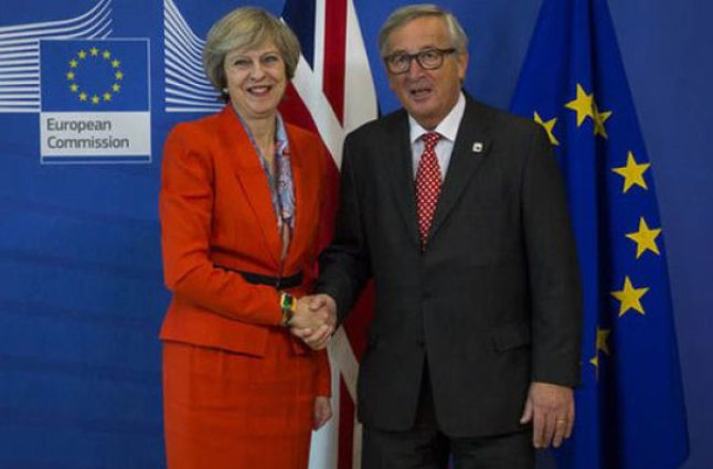Prime Minister Theresa May and President of the European Commission Jean-Claude Juncker at a conference to discuss Britain's future. Credit @pinterest.com.