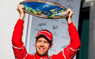 Sebastian Vettel celebrates with the race trophy after his victory in Melbourne. Credit @tumblr.com.