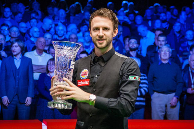Judd Trump with the tournament trophy. Credit @World Snooker via Facebook.