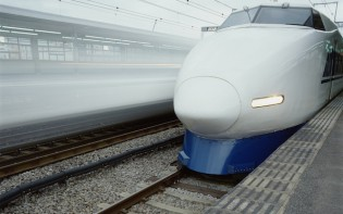A stationary bullet train at a station