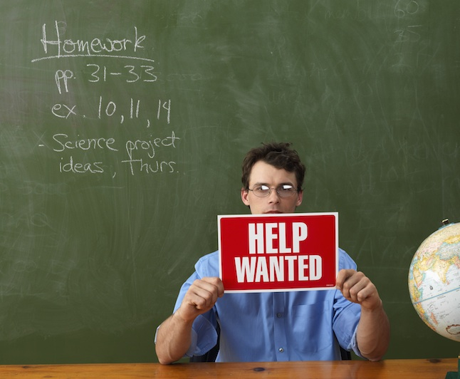 Teacher with Help Wanted Sign