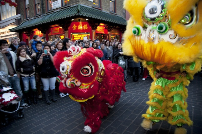 UK - London - Chinese New Year dragons dance on Gerrard Street Soho