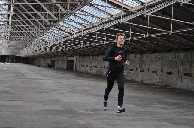 Karina Thompson running round Salts Mill © Hannah Coaten