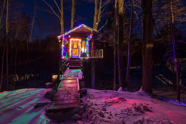 The Tiny Fern treehouse lit up with fairy lights in winter. Credit@Sebastien Barre via flickr.com