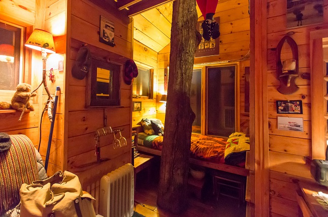 Inside a treehouse with cosy décor. Credit@Sebastien Barre via flickr.com