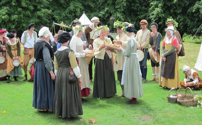 Women handfasting bread