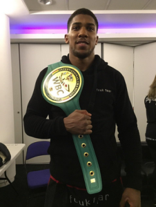 Joshua with his WBC belt. credit@anthonyfjoshua via Twitter