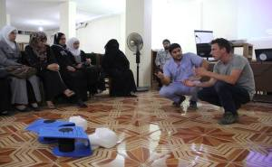Peter Kassig working with locals with the SERA foundation. Credit@SERA website