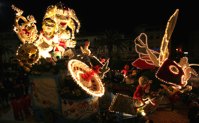 Carnival parades light up the streets at night. Credit@cidibeeviaflickr.com