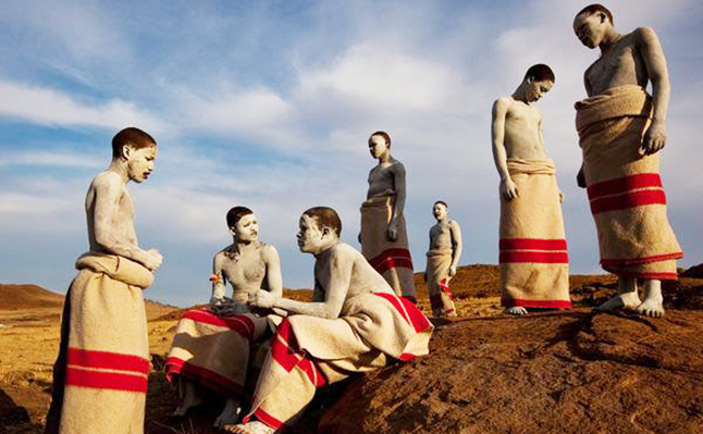 The secret rite of passage of the Xhosa people - they smear white clay over their bodies as they heal from the ritual circumcision. Credit@JamesNachtwey