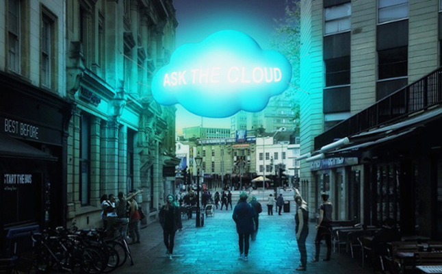 """Two fluffy clouds hang over the city, lighting up and displaying people's messages."" Credit@Tine Bech"
