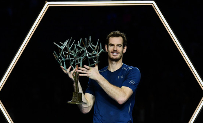 Andy Murray holding the Paris Masters' trophy aloft. Credit @tumblr.com.