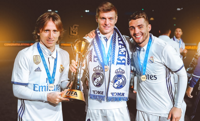 The Real Madrid players hold the tournament trophy aloft. Credit @tumblr.com.