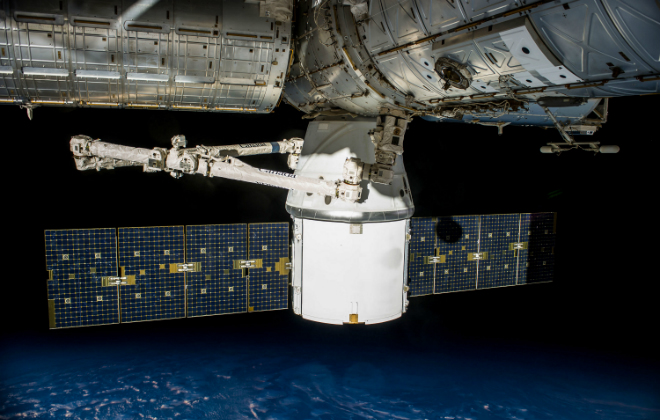 CRS 4 DRAGON BERTHED orbiting Earth Credit@ 2017 SPACE EXPLORATION TECHNOLOGIES CORP