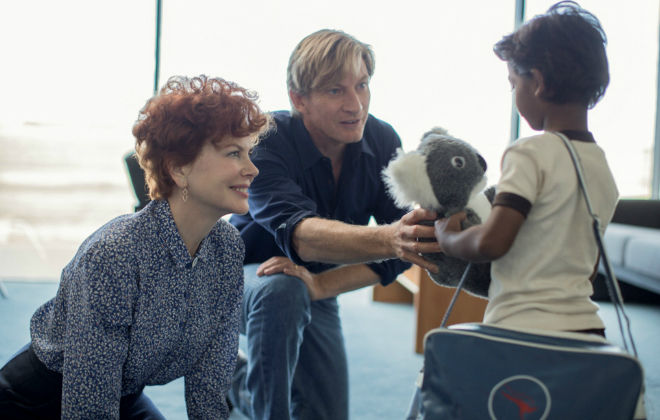 A young Saroo Brierley being adopted by his Australian Family (Nicole Kidman & David Wenham) ©THE WEINSTEIN COMPANY INC. ALL RIGHTS RESERVED.